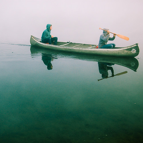 Friends in a canoe on the lake