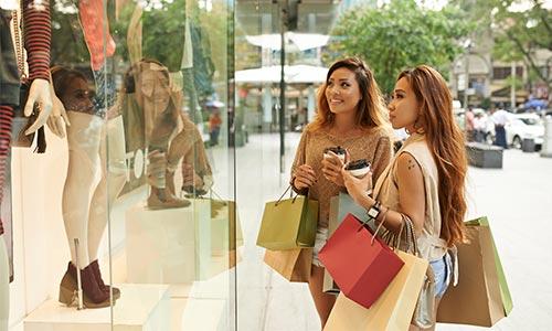 Two women shopping outside