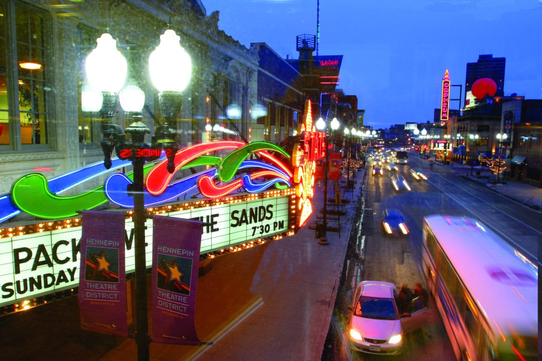 """Hennepin Avenue Theater District. Image by  <a href=""""https://flic.kr/p/eCSQs4"""" target=""""_blank"""">Meet Minneapolis</a>"""