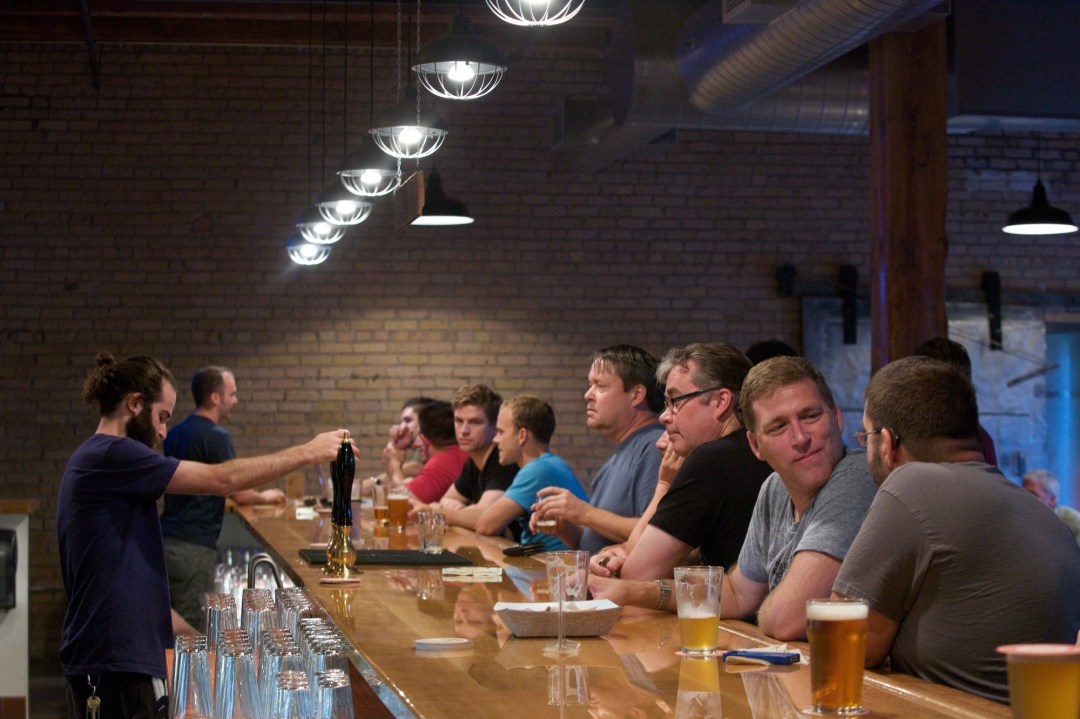 Indeed Brewery Taproom bar with people enjoying a beer