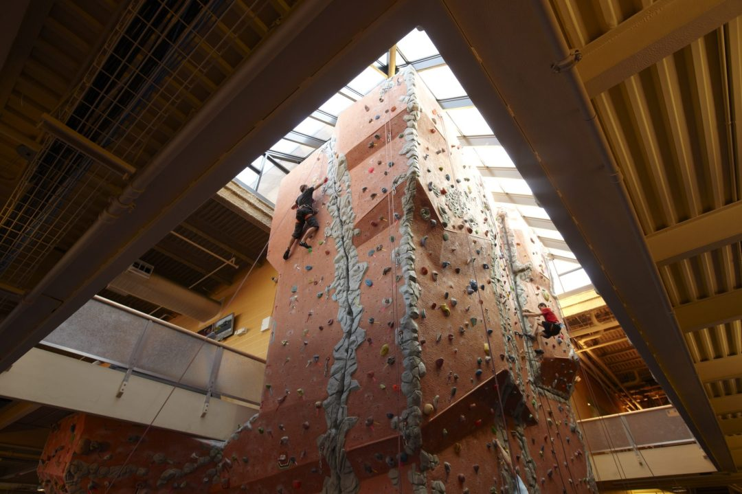 A man climbing an indoor rock wall.
