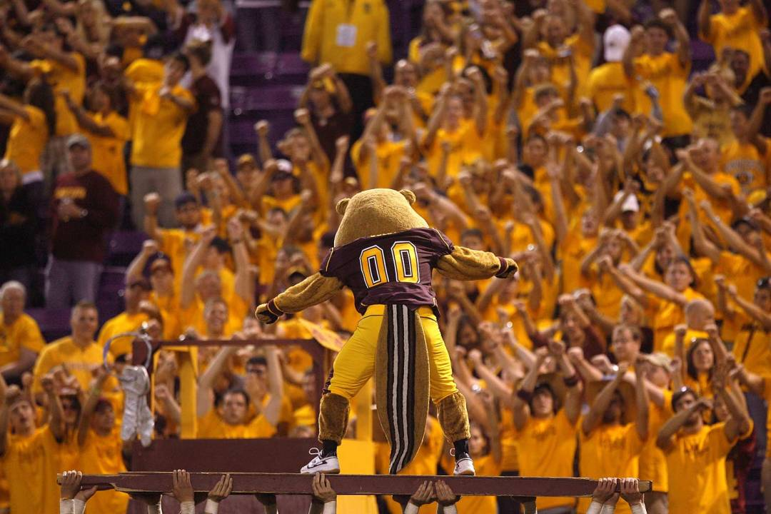 Goldy Gopher pumping up the student section at a game.