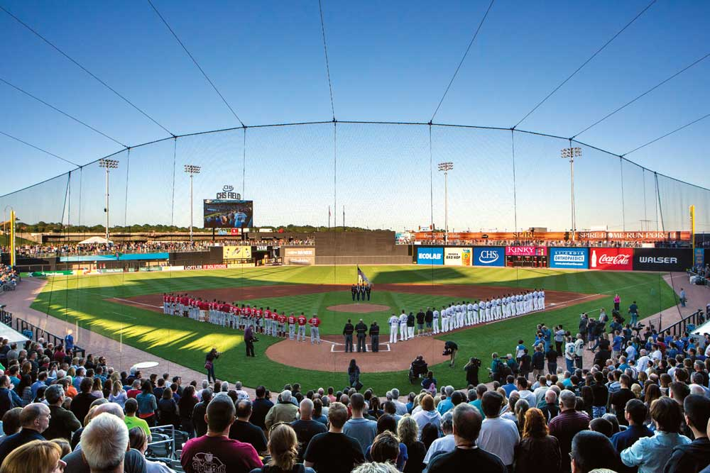 Players and the crowd standing for the National Anthem before a Saints game at CHS Field, which is one of the stops on the Metro Transit Green Line.