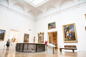 People observing art in an airy room in an art museum