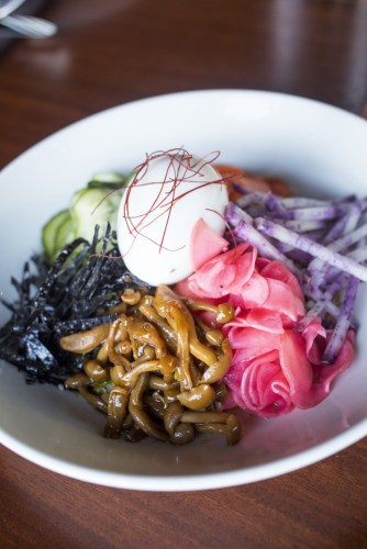 Colorful entree at Young Joni, with pickled red onion and a soft poached egg.