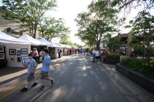 Visitors browse for artwork at the Edina Art Fair.