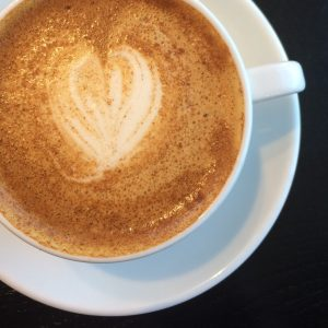 Photo of a latte in a mug at the Angry Catfish.