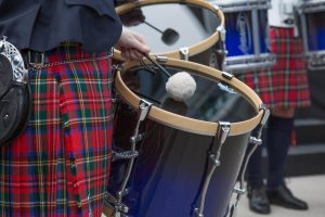 Irish drummer performing at outdoor event