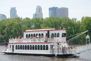 People enjoying a cruise on the Minneapolis Queen of Paradise Charter Cruises in St. Paul, Minnesota.