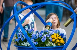 A child peers into a telescope for a close up of the brightly colored flowers at the Minnesota Arboretum.