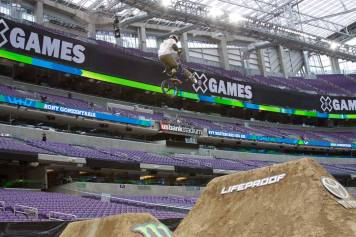 A BMX biker practicing on dirt jumps at X Games Minneapolis 2017.
