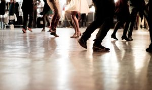 Photo of people's dancing feet.