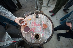 Drinks sitting on a barrel at 612Brew in Northeast Minneapolis