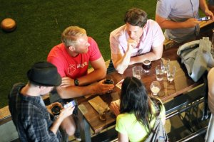 People drinking beer at Pryes Brewing Co. in downtown Minneapolis. Brewery Biking Tours