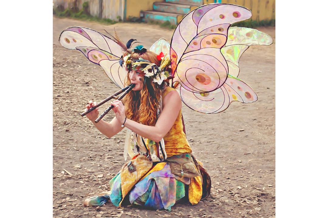 A fairy playing pipes at the Minnesota Renaissance Festival.