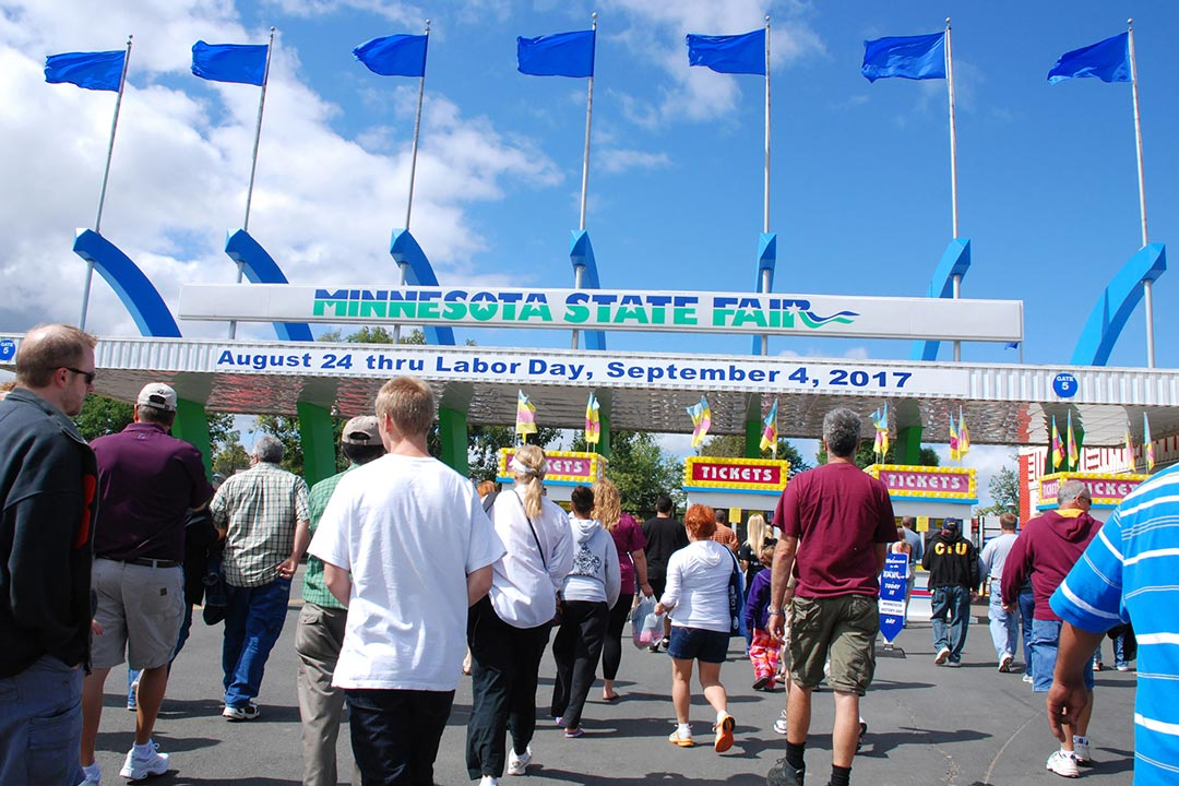 People walking through an entrance to the Minnesota State Fair.