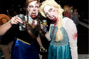 Zombies of Elsa and Anna of Frozen at the Zombie Pub Crawl.