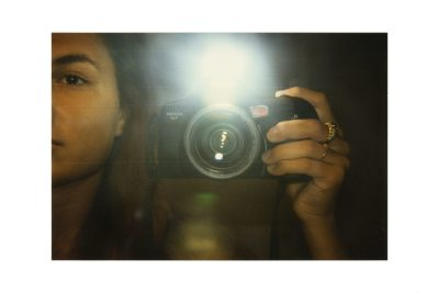 """A photograph from Anne Collier's exhibit, """"Women with Cameras (Self Portrait)."""""""