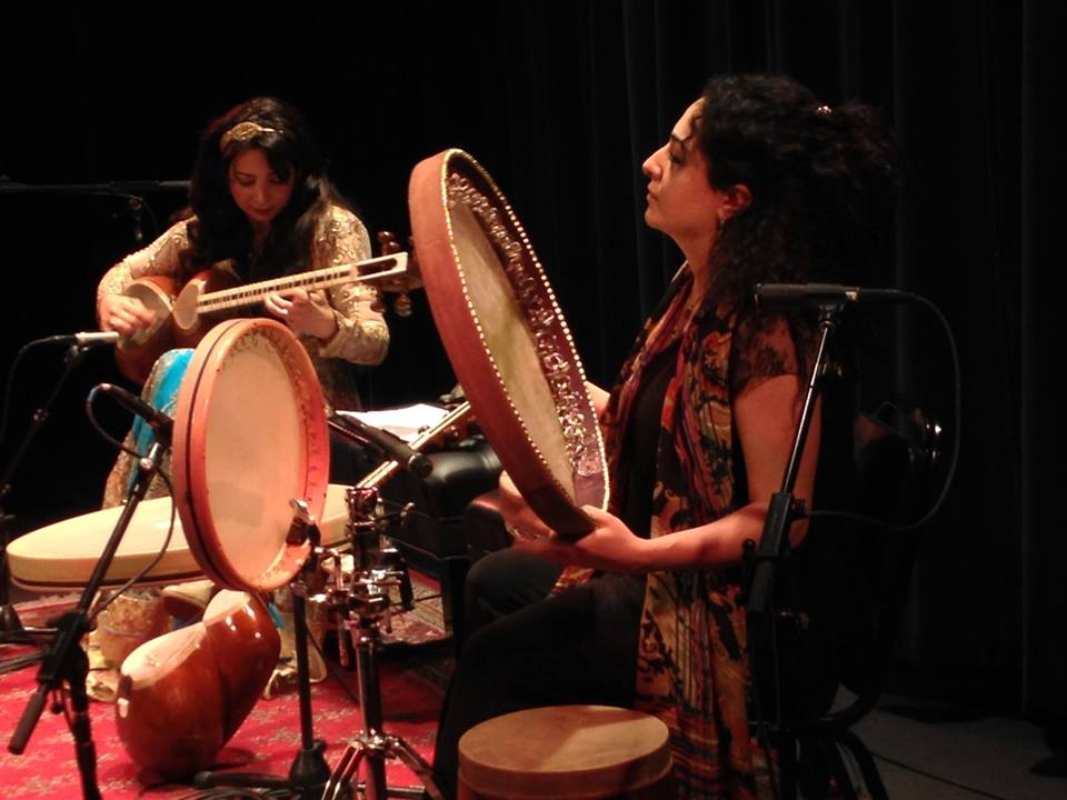 Motallebi, left, and Farahmand, right, play at a performance.