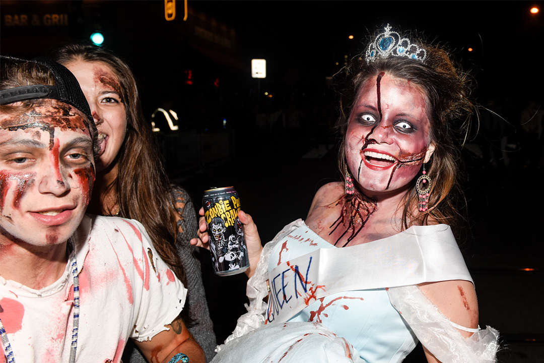 A group of people dressed as zombies at the Zombie Pub Crawl, one of the many fall festivals in Minneapolis and St. Paul.