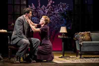 """Sara (Sarah Agnew) holds her husband's face (played by Elijah Alexander) to comfort him in """"Watch on the Rhine."""""""