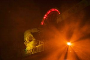 Photo by Lianna Matt. A giant skull on top of a building entrance.