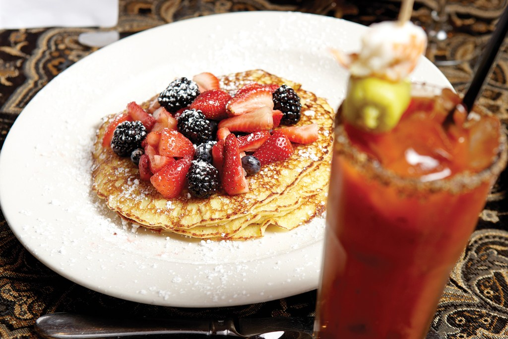 Photo of fruit-topped pancakes and a bloody Mary from Hell's Kitchen