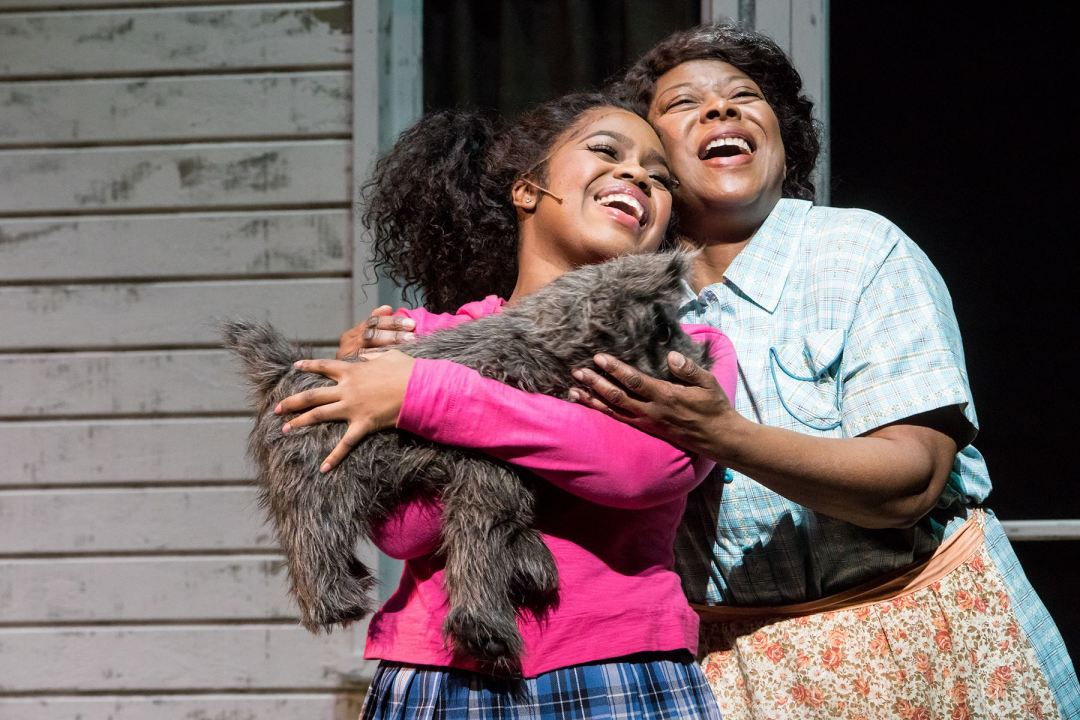 "Photo by Dan Norman. Paris Bennett (Dorothy) and Greta Oglesby (Aunt Em, Evilene) in ""The Wiz."""