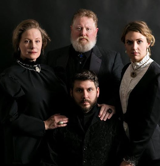 """Tina Frederickson, Tim Perfect, Hannah Steblay and Tim McVean all dressed in black looking particularly somber in Wayward Theatre Co.'s """"Hamlet,"""" which plays at the James J. Hill House throughout March."""