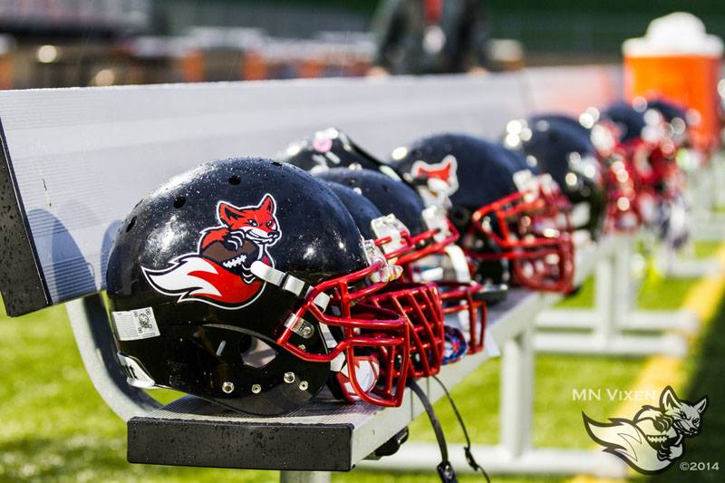 A line of the Minnesota Vixen helmets on a field bench. Courtesy Minnesota Vixen