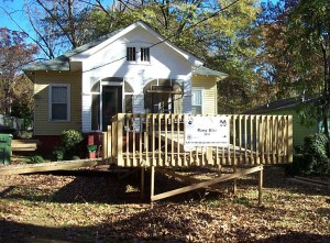 Example of bad add on - a house with a bulky wooden ramp added on