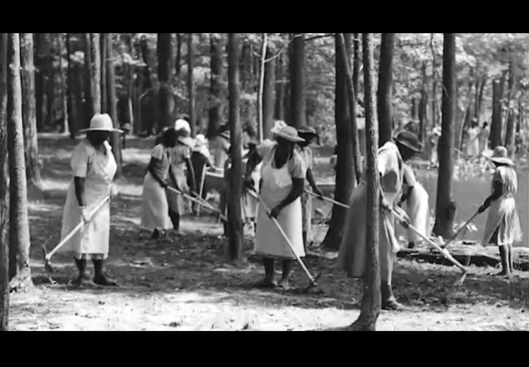 African-American women employed by the Workers Progress Administration, are tilling the land that would eventually become the Norfolk Botanical Garden, originally Azalea Gardens.
