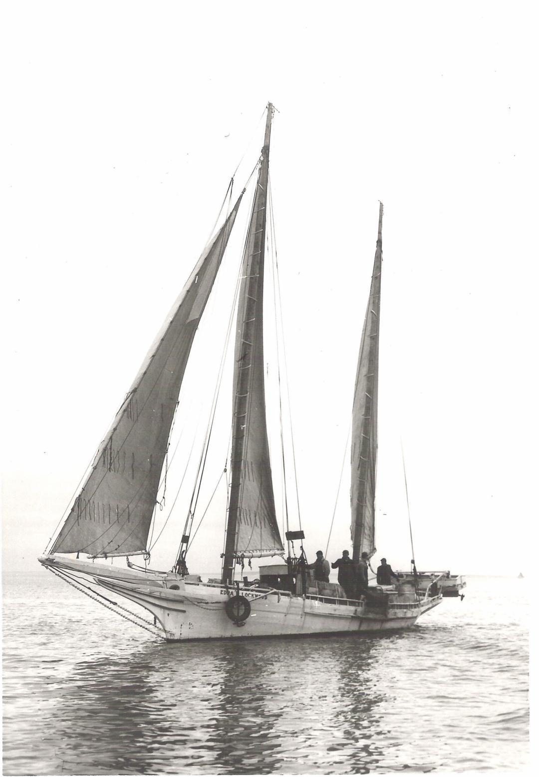 1889 bugeye Edna Lockwood dredges for oysters around 1950.