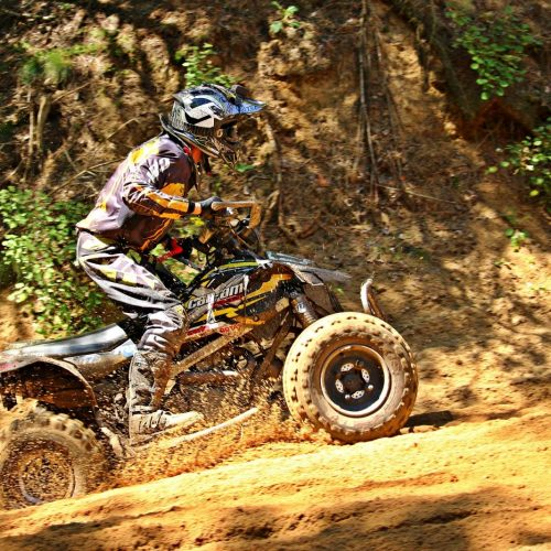 ATV Rider in mud riding through mountains