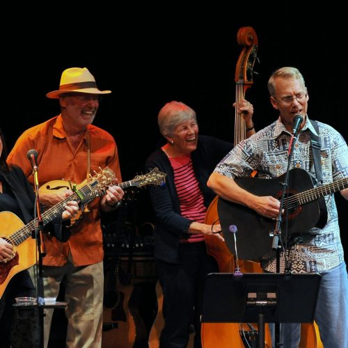 Quartet of Musicians on stage performing at High Mountain Hay Fever Music Festival