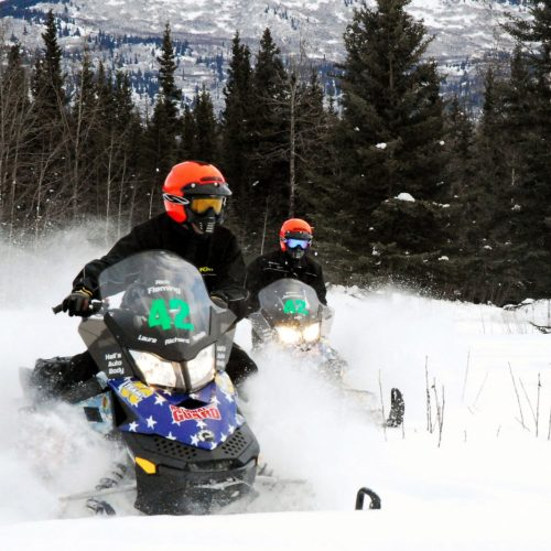Snowmobile Riders snowmobiling in the Wet Mountain Valley