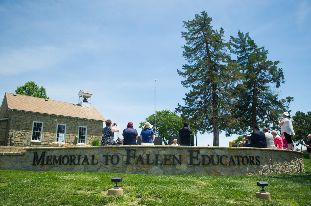 Visitors at the memorial to fallen educators on the Emporia State University campus