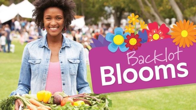 Woman with fresh produce for Backlot Blooms