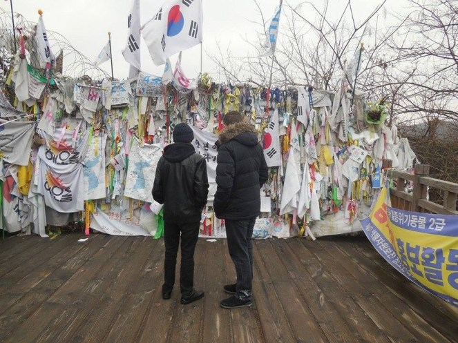 Flags, signs and ribbons left by South Koreans who want reunification.
