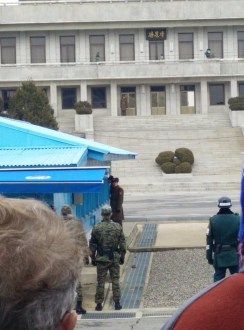 The concrete building is North Korea's command center. The soldiers looking through the windows are NK military police looking in at another tour group. We were allowed to stand here three minutes.