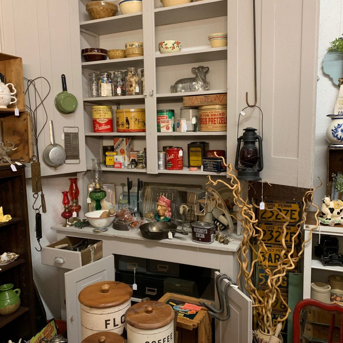 an assortment of antique kitchen items