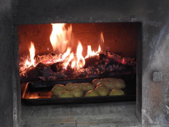 Eclairs and creme puff shells baking in the wood-burning oven