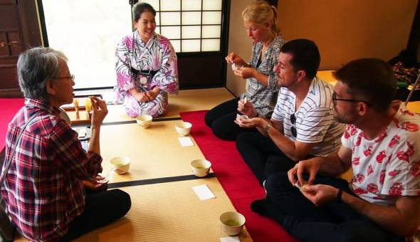 Visitors learning the traditional Japanese tea ceremony and how to make matcha