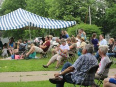 Photo of attendees enjoying outdoor concert at the Chocolate Stroll