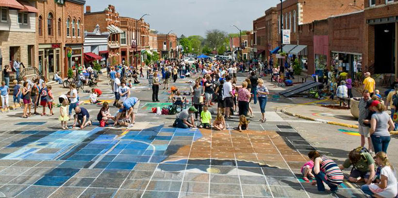 """Chalk the Walk 2015 photo of the street and participants working on the collaborative piece of art, Grant Wood's """"American Gothic"""""""