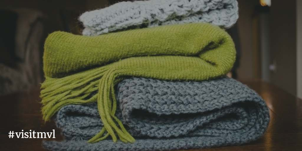 Stack of knit scarves