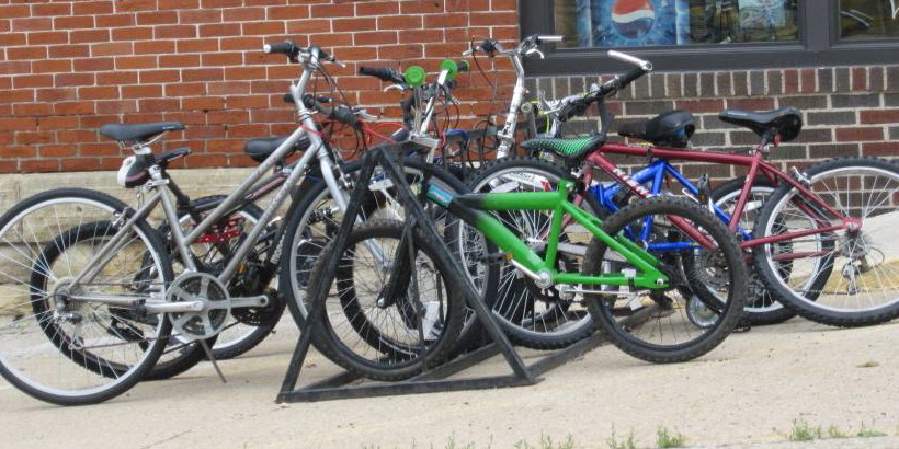 Group of bikes parked on bike rack