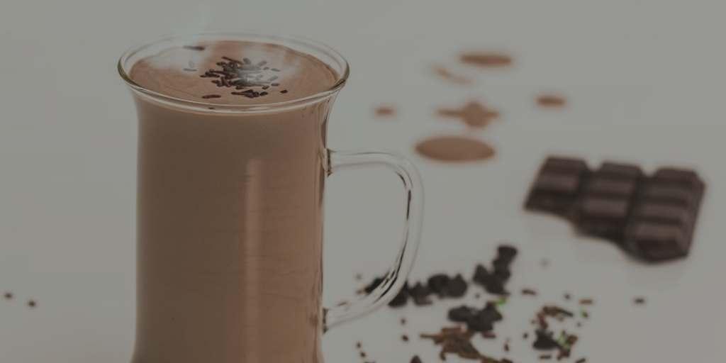 Clear mug of hot cocoa
