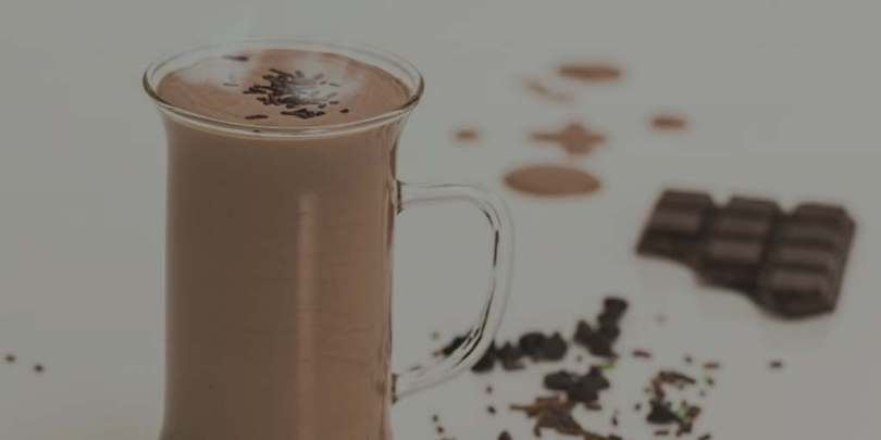 Clear mug of hot cocoa