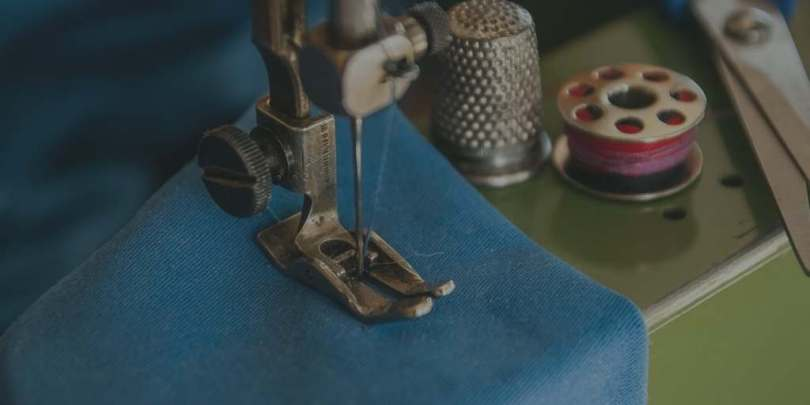 Sewing maching with blue cloth